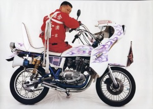That is certainly NOT an American Biker's ride.... He's not even color-coordinated!