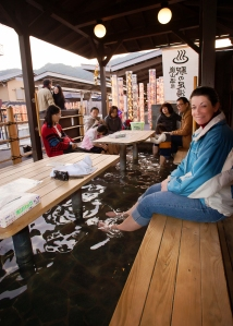 Kyoto Japan Winter 2014, Arashiyama, Jody relaxing her feet in the train station footbath