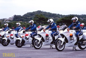 Okay, the cops wear helmets.  But apparently don't know how to use kickstands....