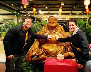 China 2014, Xian, Dumpling Dinner, rubbing buddha's belly for good luck and long life