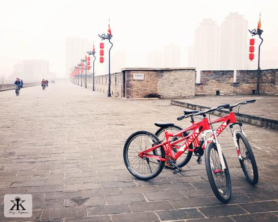 China 2014, Xian, early morning bikes on the old city wall WM