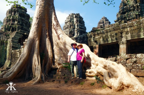Cambodia 2015, Banteay Kdei, dwarfed by tree roots WM