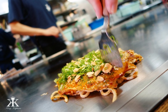 Cutting into our very own fresh Hiroshima-style Okonomiyaki