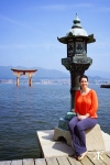 Miyajima 2015, Itsukushima Shrine, Jody seated at the shrine dock's edge (floating Torii) WM
