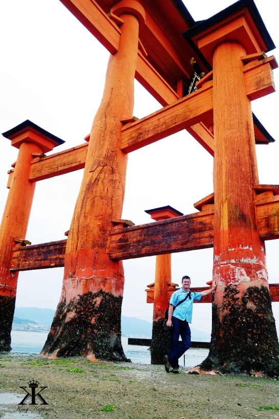 Miyajima 2015, Itsukushima Shrine, Kevin for scale of the floating torii's base at low tide WM